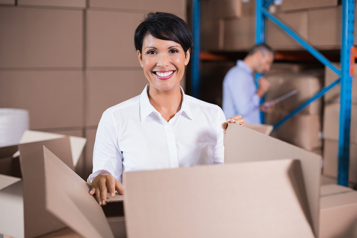 Warehouse employee packing a box